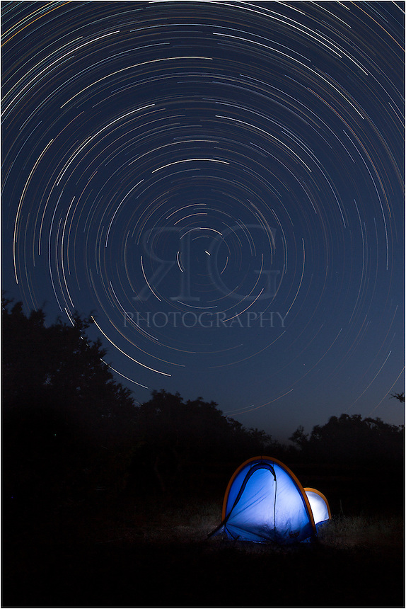 This picture taken in the Texas Hill Country shows a long exposure of star trails circling the north star in the wee hours of the morning. I lit up the tent with a flash light.<br />