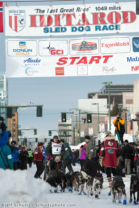 Nathan Schroeder and team leave the ceremonial start line with an Iditarider at 4th Avenue and D Street in downtown Anchorage, Alaska on Saturday, March 5th during the 2016 Iditarod race. Photo by Joshua Borough/SchultzPhoto.com