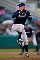 Chris Dwyer (28) of the Northwest Arkansas Naturals winds up during a game against the Springfield Cardinals on May 13, 2011 at Hammons Field in Springfield, Missouri.  Photo By David Welker/Four Seam Images.