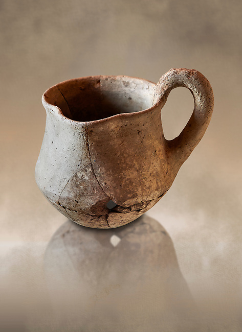 Hittite terra cotta cult side handled spouted jug. Hittite Period 1650 - 1450 BC, Ortakoy Sapinuvwa .  Çorum Archaeological Museum, Corum, Turkey. Against a warm art bacground.