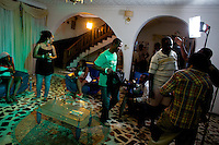 """Actors and crew get ready to shoot a scene on the set of a 21 episodes Nollywood Soap production called """"Close Shave""""  in Lagos, Nigeria on Sunday August 9 2009...Currently Nigerian films outsell Hollywood films in Nigeria and many other African countries. Nollywood is a nascent film industry in Nigeria, growing within the last two decades to become the third largest film industry on the planet, behind the United States and Indian film industries. Nigeria has a US$250 million movie industry, churning out some 200 movies for the home video market every month."""