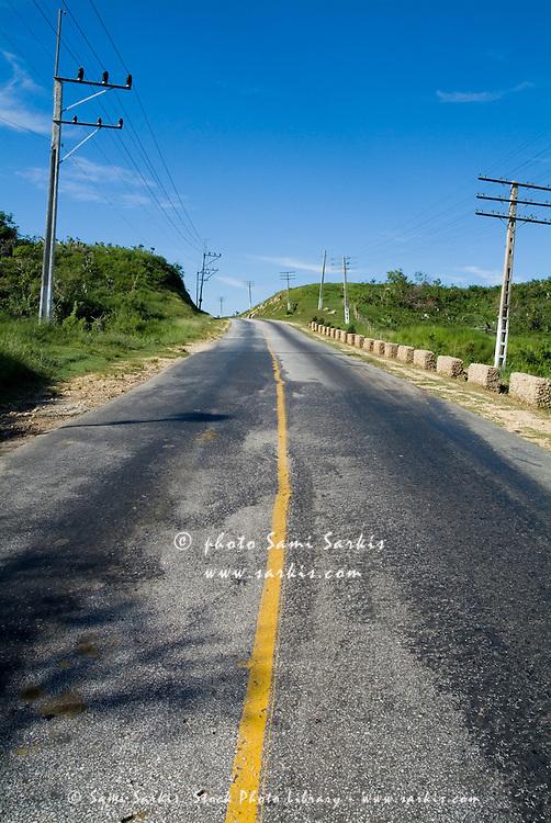 Rural road lying empty in the Valle de los Ingenios, Trinidad, Cuba.