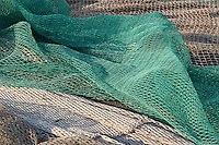 Reti da pesca sulla banchina. Fishing nets on the quay......