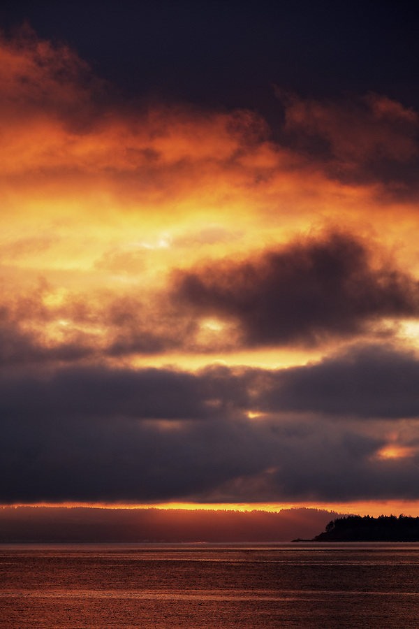 A stormy sunrise over Admiralty Inlet Fort Worden State Park, Port Townsend, Washington, USA