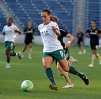 Red Stars defender Whitney Engen (9) dribbles the ball.  The FC Gold Pride defeated the Chicago Red Stars 3-2 at Toyota Park in Bridgeview, IL on August 22, 2010