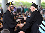 Interim President Chester Burton congratulates Spencer Dorsey during the Western Nevada College commencement at the Pony Express Pavilion, in Carson City, Nev., on Monday, May 19, 2014. <br /> Photo by Cathleen Allison/Nevada Photo Source