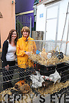 PIC SHOWS HELEN O SULLIVAN AND PAULINE WHELTON KENMARE ADMIRE THE CHICKENS FOR SALE KENMARE FAIR.