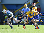 Chris Crummey of Dublin in action against David Reidy of Clare during their National Hurling League game at Cusack Park. Photograph by John Kelly.