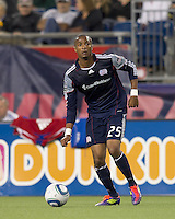 New England Revolution defender Darrius Barnes (25) looks to pass. In a Major League Soccer (MLS) match, the New England Revolution defeated FC Dallas, 2-0, at Gillette Stadium on September 10, 2011.