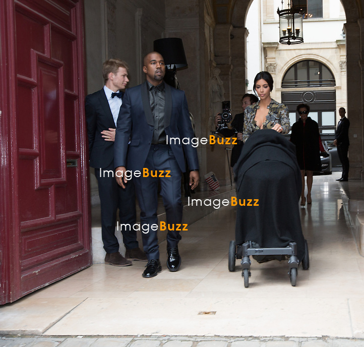 Kim Kardashian and Kanye West leave their Paris apartment with baby and Kris Jenner to attend pre-wedding celebrations<br /> France, Paris, 23 May, 2014.