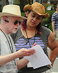 Market Committee Member, John Bassler, conferring with, Market Manager, Christine Moss, seen on the job at the Saugerties Farmer's Market on Main Street in the Village of Saugerties, NY, on Saturday, June 10, 2017. Photo by Jim Peppler. Copyright/Jim Peppler-2017.