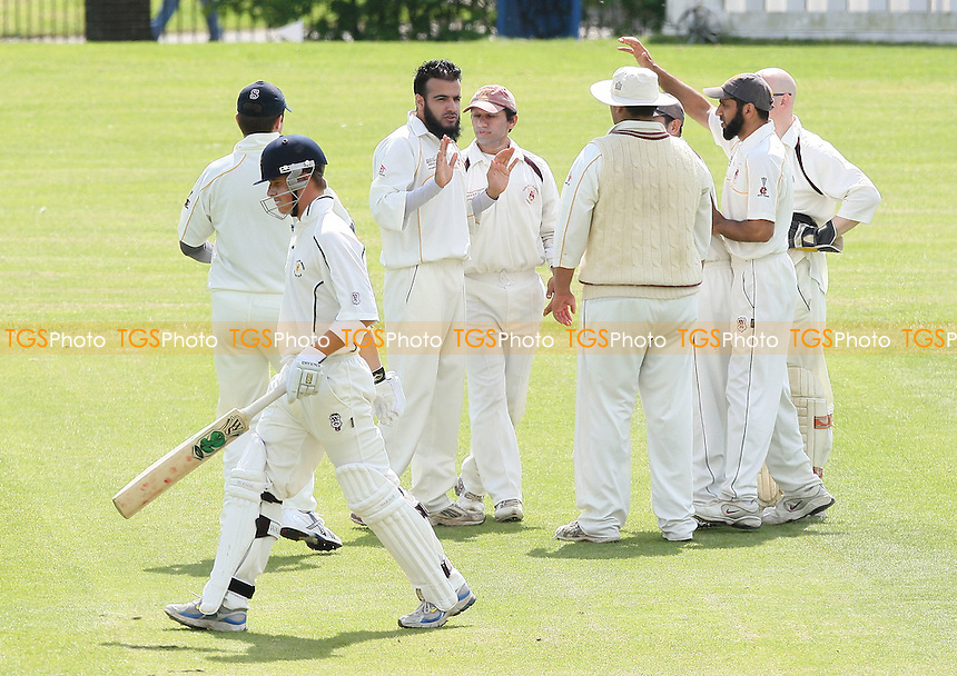 I Shah of Hainault & Clayhall claims the wicket of T Thompson (foreground) of Ardleigh Green and celebrates with his team mates - Ardleigh Green CC vs Hainault & Clayhall CC - Essex Cricket League Cup at Central Park - 02/05/09 - MANDATORY CREDIT: Gavin Ellis/TGSPHOTO - Self billing applies where appropriate - 0845 094 6026 - contact@tgsphoto.co.uk - NO UNPAID USE.