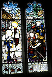 Stained glass nativity scene of shepherds and baby Jesusby Charles Eamer Kempe, Church of St Botolph, Burgh, Suffolk