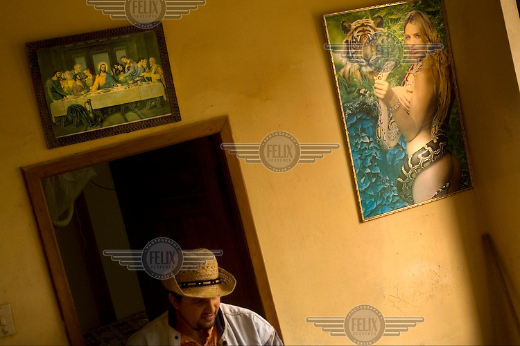 A man exits his hotel room in the city of Borbon, a community on the Cayapas River.