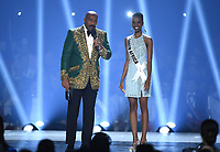 ATLANTA, GA - DECEMBER 8: 2019 MISS UNIVERSE: Host Steve Harvey and Miss South Africa, Zozibini Tunzi appear on the 2019 MISS UNIVERSE competition airing LIVE on Sunday, Dec. 8 (7:00-10:00 PM ET live/PT tape-delayed) on FOX. (Photo by Frank Micelotta/FOX/PictureGroup)
