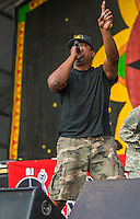 Public Enemy performs at the 2014 Jazz and Heritage Festival in New Orleans, LA.