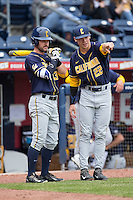 Daulton Jefferies (22) of the California Golden Bears cahts with teammate Aaron Knapp (23) prior to the game against the Duke Blue Devils at Durham Bulls Athletic Park on February 20, 2016 in Durham, North Carolina.  The Blue Devils defeated the Golden Bears 6-5 in 10 innings.  (Brian Westerholt/Four Seam Images)