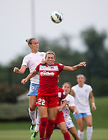 Stephanie Ochs (22) of the Washington Spirit goes up for a header with Leslie Osborne (12) of the Chicago Red Stars during the game at the Maryland SoccerPlex in Boyds, Md.   Chicago defeated Washington, 2-0.