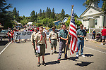 Independence Day celebration Main Street, Mokelumne Hill, California..Boy Scouts carry the flag
