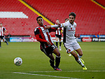 Jake Bennett of Sheffield Utd tussles with Joe Edwards of Walsall during the Carabao Cup First Round match at Bramall Lane Stadium, Sheffield. Picture date: August 9th 2017. Pic credit should read: Simon Bellis/Sportimage