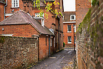 small urban street with red brick buildings in Winchester, Hampshire, England