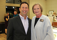 NWA Democrat-Gazette/CARIN SCHOPPMEYER Eric Pianaltno, Mercy Hospital Northwest Arkansas president, visits with Pat Curran, foundation board vice-chairwoman and the group's 2019 Volunteer of the Year, visit at the Patrons Party on Nov. 6 at Blakeman's Fine Jewelry in Rogers.
