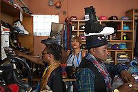 """KINSHASA, DEMOCRATIC REPUBLIC OF CONGO - FEBRUARY 12: Mzee Kindingu (l), the leader of the Sapeurs group The Leopards shops for shoes in one of the fashion shops in Matonge area February 12, 2016 in Kinshasa, DRC. The word Sapeur comes from SAPE, a French acronym for Société des Ambianceurs et Persons Élégants. or Society of Revellers and Elegant People. and it also means, .to dress with elegance and style"""". Most of the young Sapeurs are unemployed, poor and live in harsh conditions in Kinshasa, a city of about 10 million people. For many of them being a Sapeur means they can escape their daily struggles and dress like fashionable Europeans. Many hustle to build up their expensive collections. Most Sapeurs could never afford to visit Paris, and usually relatives send or bring clothes back to Kinshasa. (Photo by Per-Anders Pettersson)"""