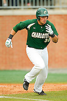 Miguel Rodriguez #30 of the Charlotte 49ers hustles down the first base line against the Saint Peter's Peacocks at Robert and Mariam Hayes Stadium on February 18, 2012 in Charlotte, North Carolina.  Brian Westerholt / Four Seam Images