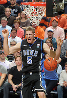 Feb. 16, 2011; Charlottesville, VA, USA; Duke Blue Devils forward Mason Plumlee (5) dunks the ball during the second half of the game against the Virginia Cavaliers at the John Paul Jones Arena. The Duke Blue Devils won 56-41.  Credit Image: © Andrew Shurtleff