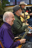 NWA Democrat-Gazette/FLIP PUTTHOFF <br /> A SONG AND A SMILE<br /> Henry Easter (from left) shares a joke Tuesday Dec. 4 2018 with the audience and musicians Jeff Davis and Marty Mullen while he plays mandolin with the Old Town String Band at the Billy V. Hall Senior Activity and Wellness Center in Gravette. The band features musicians on guitar, mandolin, fiddle, ukelele, bass and more. They play at the Gravette senior center at 10 a.m. the first, second and third Tuesday of each month