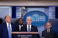 United States Vice President Mike Pence makes remarks on the Coronavirus crisis in the Brady Press Briefing Room of the White House in Washington, DC on Saturday, March 21, 2020.  From left to right: US President Donald J. Trump; US Secretary of Housing and Urban Development (HUD) Ben Carson; Vice President Pence; and Director of the National Institute of Allergy and Infectious Diseases at the National Institutes of Health Dr. Anthony Fauci.<br /> Credit: Stefani Reynolds / Pool via CNP/AdMedia
