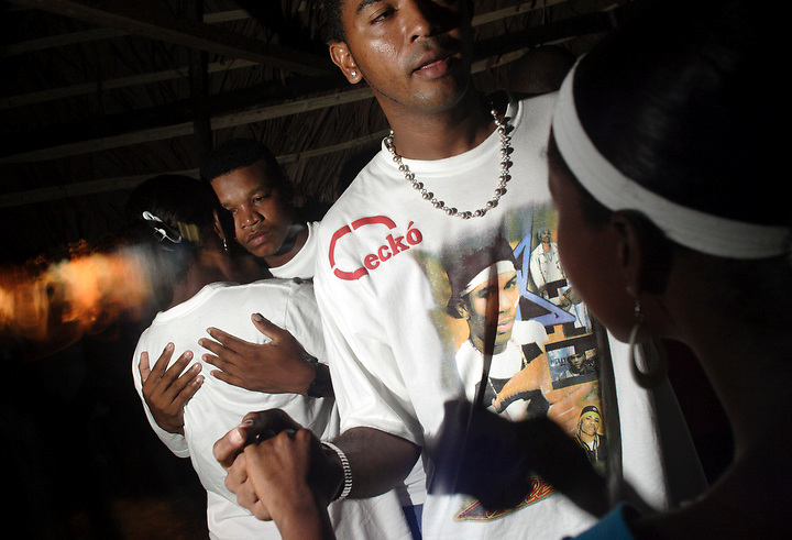 NUQUÍ, EL CHOCO, COLOMBIA -- DECEMBER 10: Dancers in Pa' Chupa' disco in the town of Nuqui on December 10, 2005. Nuquí is a small town on Colombia's isolated and untamed Pacific coast, an area sandwiched between endless miles of trackless rainforest and the Pacific Ocean. (Photo by Dennis Drenner/Aurora).