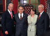 Washington, DC - July 7, 2009 -- United States Senator Al Franken (Democrat of Minnesota) poses for a group photo after participating in a mock swearing-in ceremony in the Old Senate Chamber in the U.S. Capitol in Washington, D.C. on Tuesday, July 7, 2009.  From left to right: Vice President Joseph Biden; Senator Franken; U.S. Senator Amy Klobuchar (Democrat of Minnesota); and former Vice President Walter Mondale..Credit: Ron Sachs / CNP