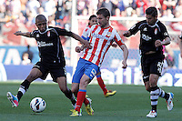 Atletico de Madrid's Gabi Fernandez (c) and Granada's Yacine Brahimi (l) and Nolito during La Liga match.April 14,2013. (ALTERPHOTOS/Acero)