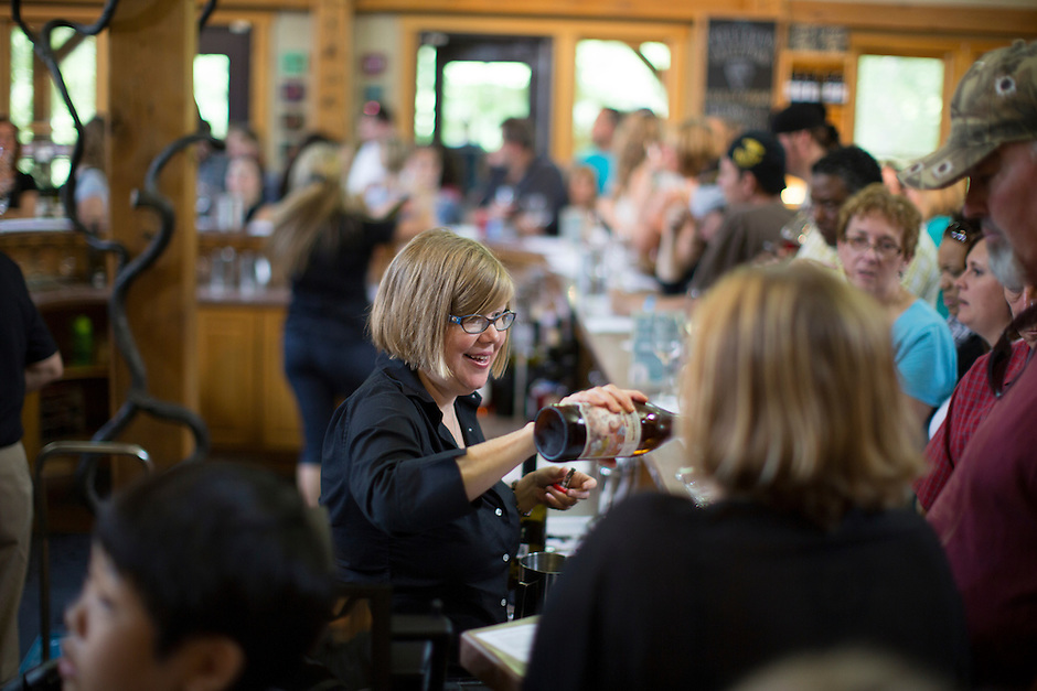 An employee pours a sample of hard cider for a tasting during Oliver Winery's Harvest Wine Festival on Saturday, Sept.. 25, 2014. (Photo by James Brosher)