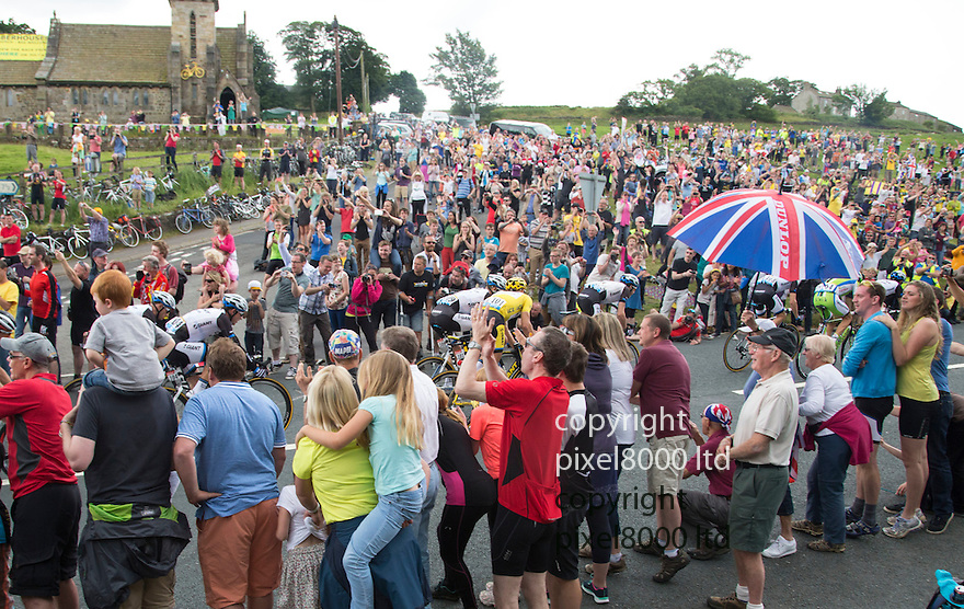 Grand Depart - Tour de France 2014<br /> Yorkshire England.<br /> Second stage passes through &quot;Blubberhouses Moor&quot;<br /> on the road from Harrogate<br /> Huge crowds wave through the yellow jersey (centre)<br /> leader Marcel Kittel - centre<br /> <br /> <br /> <br /> Pic by Gavin Rodgers/Pixel 8000 Ltd
