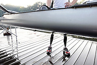 Former Marine sergeant Rob Jones stands on bionic legs by the double scull boat used to train for the rowing Wednesday July, 25, 2012 on the Rivanna River in Charlottesville, VA. Former Marine sergeant Jones, who lost both legs during an IED explosion in Afghanistan, will compete as a rower at the 2012 Paralympics in London, England. Rowing will make its appearance at the London Paralympic Games for only the second time, after its introduction at the Beijing 2008 Games. Photo/Andrew Shurtleff