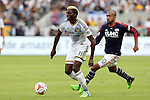 07 December 2014: Los Angeles's Gyasi Zardes (11) and New England's Teal Bunbury (10). The Los Angeles Galaxy played the New England Revolution in Carson, California in MLS Cup 2014. Los Angeles won 2-1 in overtime.
