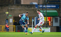 Paris Cowan-Hall of Wycombe Wanderers hits the ball past Conor Henderson of Crawley Town during the Sky Bet League 2 match between Wycombe Wanderers and Crawley Town at Adams Park, High Wycombe, England on 25 February 2017. Photo by Andy Rowland / PRiME Media Images.