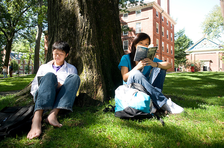 CAMBRIDGE,  MA-- Sept. 14, 2009-- Harvard students Ming Cheung, l, and Hurnan Vongsachang sit comfortably on the organic grass that has been cultivated in Harvard Yard. . CREDIT: Jodi Hilton for The New York Times