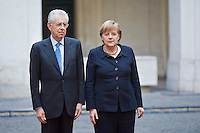 Mario Monti riceve la Cancelliera tedesca Angela Merkel a Palazzo Chigi. .Italian Prime Minister Mario Monti  waiting to meet with German Chancellor Angela Merkel at Palazzo Chigi in Rome.