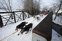 Anna Berington runs across the Chester Creek Bridge on the bike/ski trail during the ceremonial start of the Iditarod sled dog race Anchorage Saturday, March 2, 2013. ..Photo (C) Jeff Schultz/IditarodPhotos.com  Do not reproduce without permission