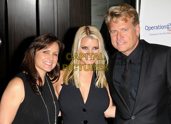 TINA SIMPSON, JESSICA SIMPSON & JOE SIMPSON.arriving at Operation Smile at the Beverly Hilton Hotel in Beverly Hills, California, USA, October 2nd 2009..half length suit tie halterneck black buttons mother father parents dad mom mum daughter family married husband wife .CAP/ROT.©Lee Roth/Capital Pictures.