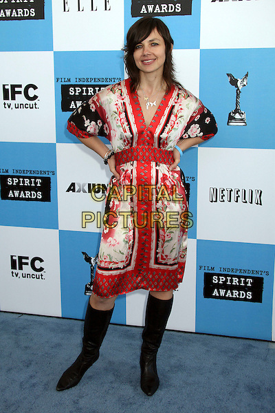 JUSTINE BATEMAN.2007 Film Independent's Spirit Awards at the Santa Monica Pier, Santa Monica, California, USA,.24 February 2007..full length red and white patterned print dress hands on hips black knee high boots.CAP/ADM/BP.©Byron Purvis/AdMedia/Capital Pictures.