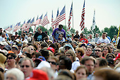 People wait  to see United States President Barrack Obama speak as he places a wreath at Abraham Lincoln National Cemetery in Elwood, Illinois on Memorial Day, Monday, May 31, 2010.     .Credit: David Banks / Pool via CNP