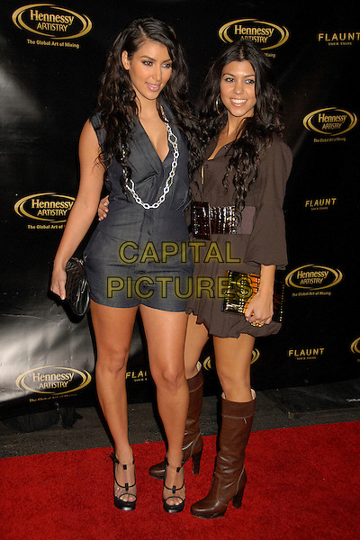 KIM KARDASHIAN & COURTNEY KARDASHIAN.Hennessy Artistry Finale Event at Paramount Studios, Hollywood, California, USA..October 10th, 2007.full length black clear platform shoes denim all in one jumpsuit necklace clutch purse brown dress belt boots sisters siblings family .CAP/ADM/BP.©Byron Purvis/AdMedia/Capital Pictures.