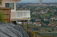"The deck of a home at the edge of the Mount Soledad landslide hangs precauriously in the air, Monday January 21 2008.  Attorneys for the homeowner allege that the home was further damaged by new movement at the site on Thursday last which their geologists say was caused when city crews graded the bottom or ""toe"" of the landslide area."