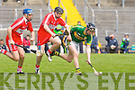 Kerry's Darren Dineen gets away from Derry's Kevin Hinphey and Alan Grant in the Christy Ring Cup at Austin Stack park, Tralee on Saturday.