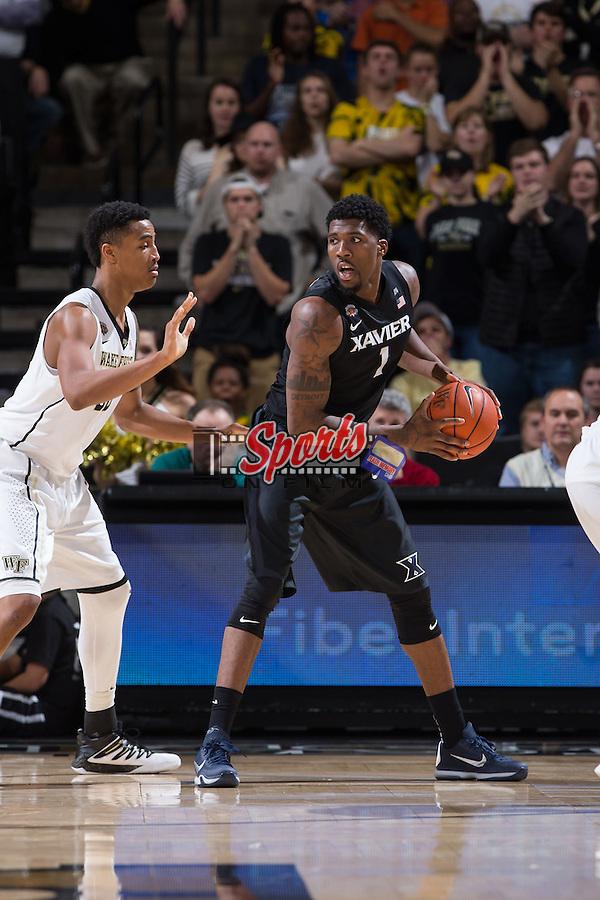 Jalen Reynolds (1) of the Xavier Musketeers is guarded by John Collins (20) of the Wake Forest Demon Deacons during second half action at the LJVM Coliseum on December 22, 2015 in Winston-Salem, North Carolina.  The Musketeers defeated the Demon Deacons 78-70.  (Brian Westerholt/Sports On Film)