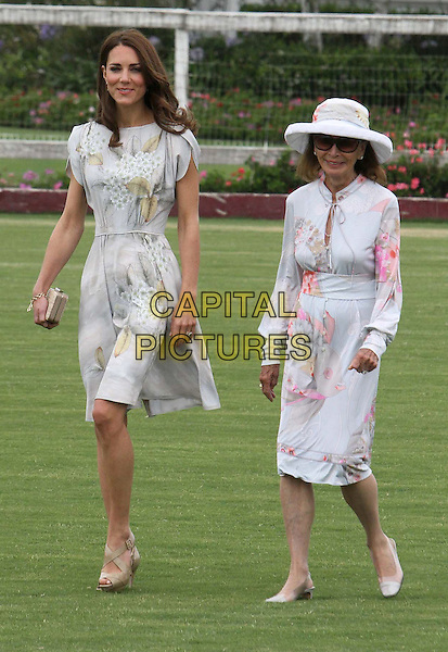 Catherine, Duchess of Cambridge .Audi At The Foundation Polo Challenge held at the Santa Barbara Polo & Racquet Club, Santa Barbara, California, USA, 9th July 2011..royal royalty princess Kate Middleton  tour  America full length grey gary floral print dress grass walking beige nude shoes clutch bag green leaves .CAP/ADM/KB.©Kevan Brooks/AdMedia/Capital Pictures.